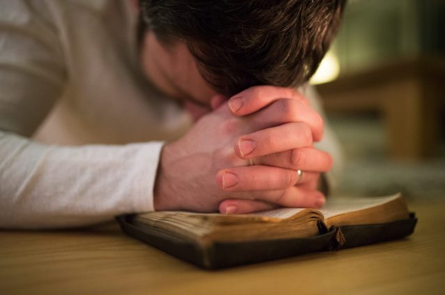 praying man on bible